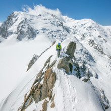 A Male Alpinist Heads Across A...