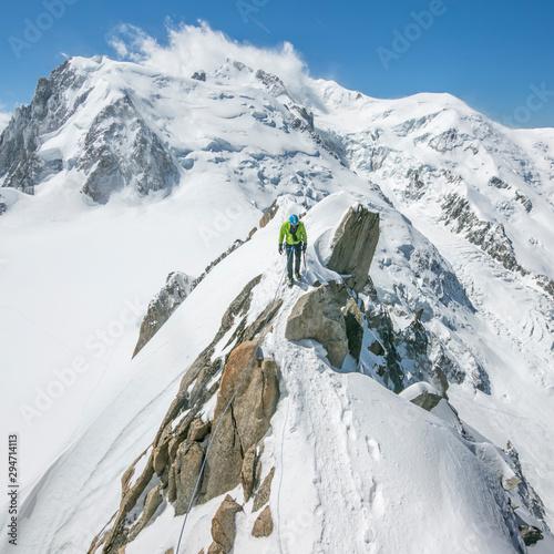 Mountain climber standing on ridge of Mont Blanc
