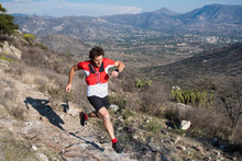 Strong Athletic Man Trail Running In The Desert In El Arenal, Hidalgo, Mexico