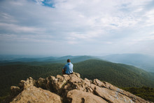 A Young Adult Overlooks A Wide Mountain Range In Virginia