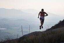 Train Runner Running With Moun...