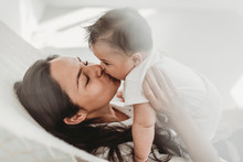 Mother Kissing Baby Daughter H...