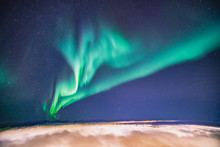 Northern Lights Flying High Ov...