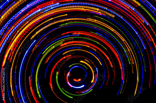 Photo sur Toile Spirale Rotating neon lights, spinning bright colorful laser lights background, modern nightlife and party concept, disco and dancing nightclubs pattern