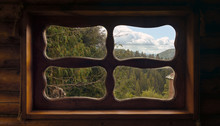 View Of Mountains From Wooden Traditional Hut Window