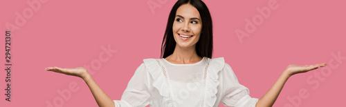 Fotografija panoramic shot of cheerful woman in white dress gesturing isolated on pink