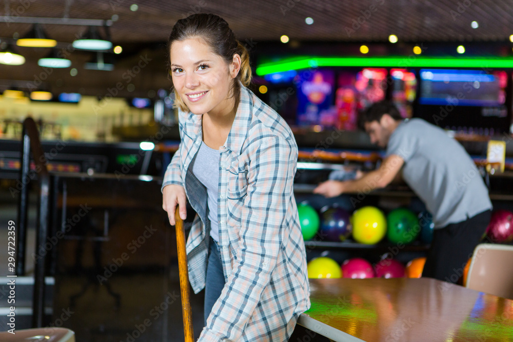 Fototapety, obrazy: young woman doing cleaning the bowling center