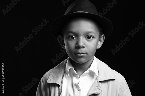Black and white portrait of cute African-American boy on dark background Canvas Print