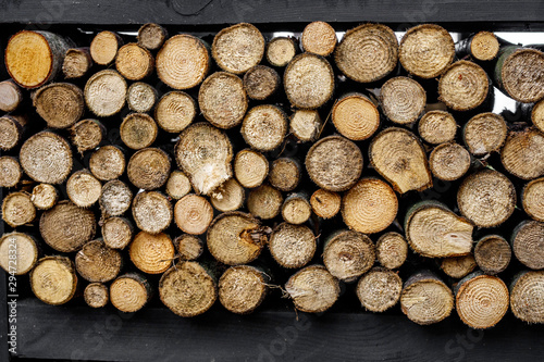 Round firewood texture. Pile of wood logs ready for winter.
