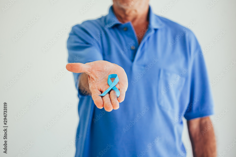 Fototapeta Prostate Cancer Awareness. Man with light Blue Ribbon for supporting people living and illness. Men Healthcare and World cancer day concept