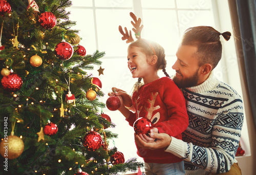 Spoed Foto op Canvas Dinosaurs happy family father and child girl decorated Christmas tree