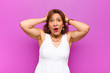 canvas print picture - middle age woman feeling clueless and confused, having no idea, absolutely puzzled with a dumb or foolish look against purple wall