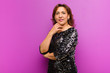 Leinwanddruck Bild - middle age pretty woman isolated and posing against flat background