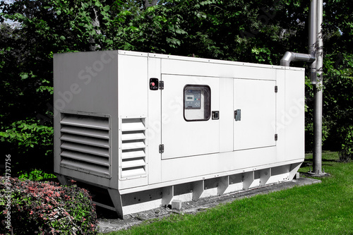 Fotografiet emergency generator for uninterruptible power supply, diesel installation in an iron casing with an electric switchboard power management