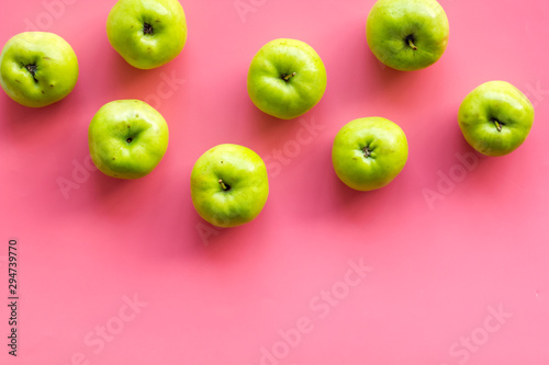 Green apples pattern on pink background top view frame space for text - 294739770