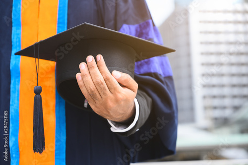 Stampa su Tela  Close up Graduation holding graduation cap education concept