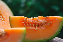 Cut Melon With Orange Pulp And...