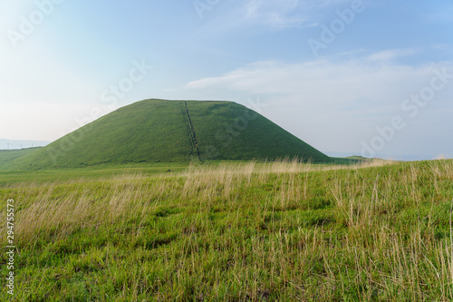 Mount Aso volcano Kome Zuka in landscape focus Kuju national park ,green meadow in front ,Kumamoto, Japan Canvas Print