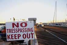 No Trespassing Keep Out Sign At Boatyard Harbor Marina Sun Blast