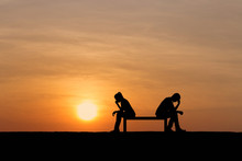 Silhouettes Of Couple Man And Woman Broken Heart At Nature Sunset. Love Concept.