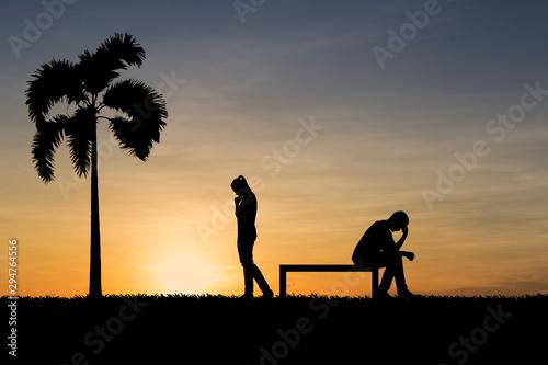 Fényképezés Silhouettes of couple man and woman broken heart at nature sunset
