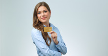 Smiling Woman Holding Credit Card In Front Of.