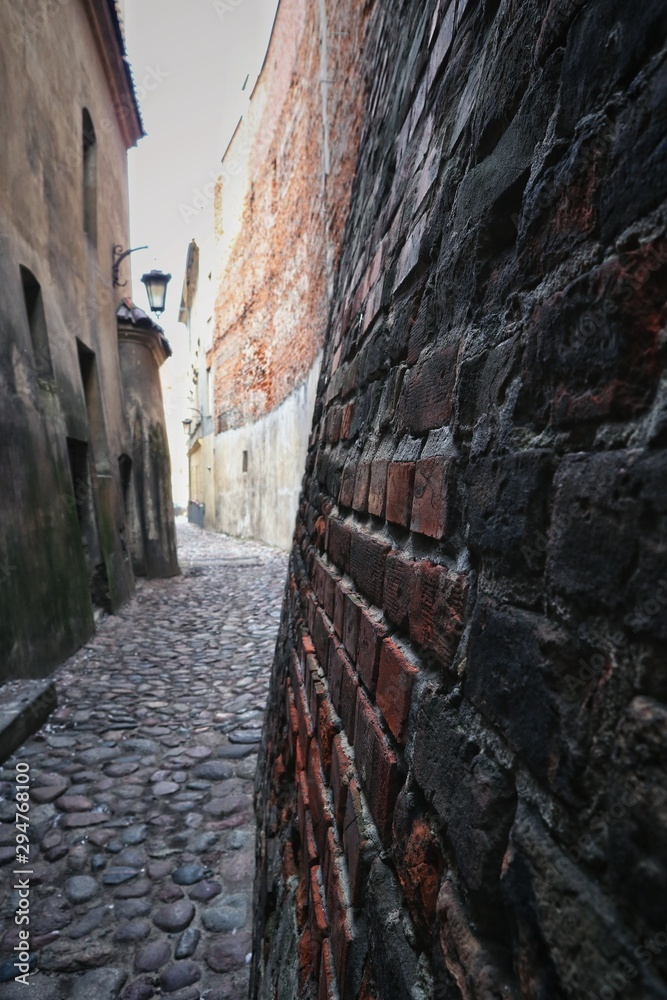 A narrow street among tenements of the old town