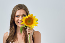 Smiling Woman With Nude Shoulders Holding One Sun Flower.