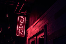 Neon BAR Sign Lights Up The Do...