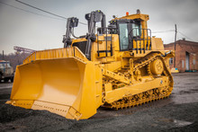 Yellow Bulldozer At Constructi...