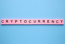 Cryptocurrency Word Wooden Cubes On A Blue Background
