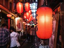 Japan Bar Street Izakaya Red Light Sign With People Drinking. Tokyo Nightlife