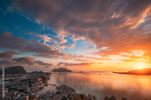 Alesund, Norway. Amazing Natural Bright Sunset Dramatic Sky In Warm Colours Above Alesund Islands. Famous Norwegian Landmark And Popular Destination. Top View