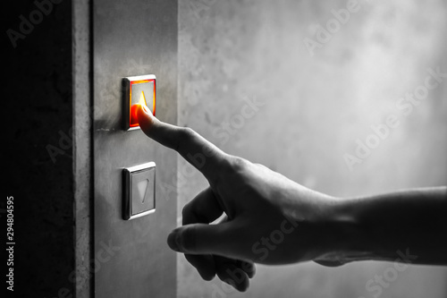 woman finger presses the elevator up button upper high level floor Canvas Print