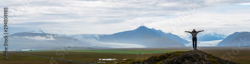 Obraz Panorama picture of asian woman solo travel enjoy at nature on the top mountain with Skaftafellsjokull glacier as a Background in Iceland - fototapety do salonu