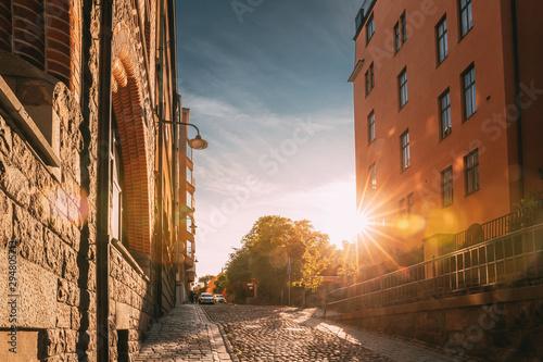 Foto auf Gartenposter Stockholm Stockholm, Sweden. Sunshine During Sunset Above Stockholm Street. Beautiful Street With Multi-storey House In Sunny Summer Evening.
