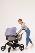 Blonde Woman Mother Walking With Baby In Pram