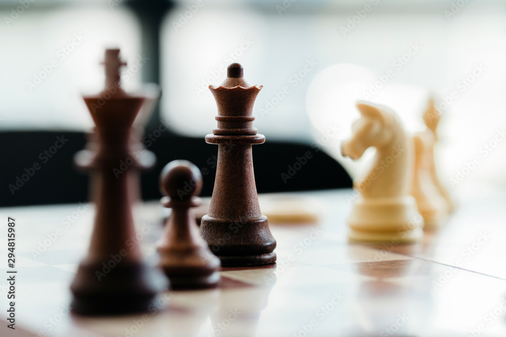 Fototapety, obrazy: wood chess pieces on board game., strategy and competition in business concept.