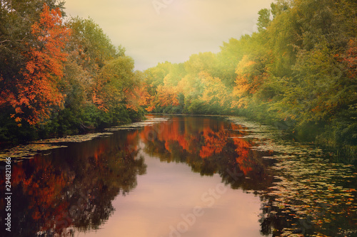 River in the autumn forest at sunset. Fototapete