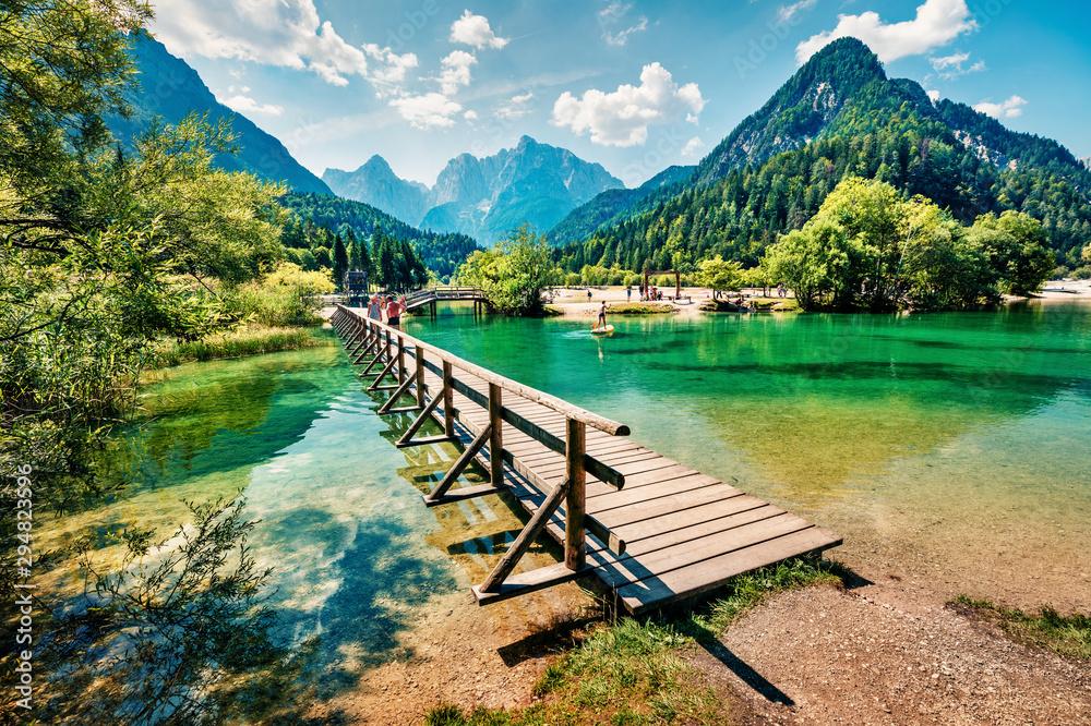 Amazing morning view of Jasna lake. Attractive summer scene of Julian Alps, Gozd Martuljek location, Slovenia, Europe. Wonderful landscape of Triglav National Park. Traveling concept background.