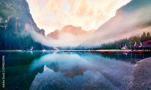 Foggy morning view of Braies (Pragser Wildsee) lake. Fantastic summer sunrise in Fanes-Sennes-Braies national park, Dolomiti Alps, South Tyrol, Italy, Europe. Beauty of nature concept background.