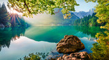 Fototapeta Natura - Impressive morning view of Fusine lake. Attractive summer scene of Julian Alps with Mangart peak on background, Province of Udine, Italy, Europe. Traveling concept background.