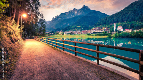 Foto auf Leinwand Blau türkis Splendid sunset scene of Santa Caterina lake. Great summer view of Auronzo di Cadore / Aulus-les-Bains resort, Province of Belluno, Italy, Europe. Traveling concept background.
