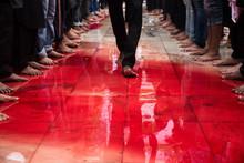 A Man Walks Through The Blood....