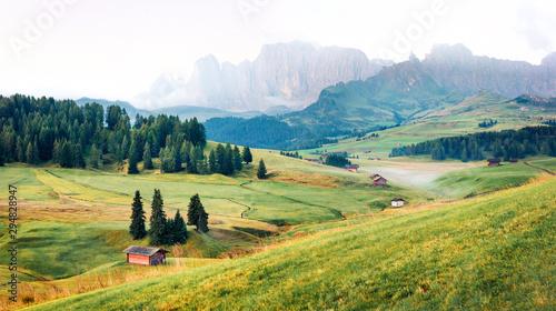 Misty morning scene of Compaccio village, Seiser Alm or Alpe di Siusi location, Bolzano province, South Tyrol, Italy, Europe Wallpaper Mural