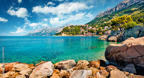 Splendid morning seascape of Adriatic sea. Sunny summer view of small beach in famous resort - Brela, Croatia, Europe. Beautiful world of Mediterranean countries.