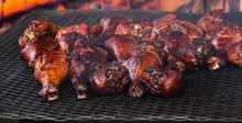 Many Smokey Turkey Legs On A Grill At A County Fair