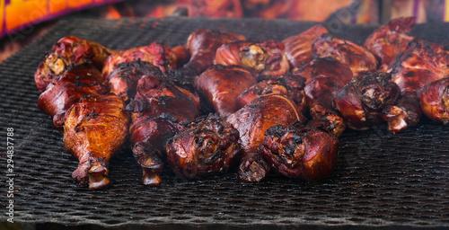 Obraz na plátně  Many Smokey Turkey Legs on a Grill at a County Fair