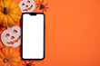 canvas print picture - Blank white smartphone screen with pumpkins and spiders