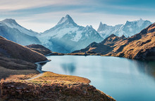 Gorgeous Evening Panorama Of Bachalp Lake / Bachalpsee, Switzerland. Exotic Autumn Sunrise In Swiss Alps, Grindelwald, Bernese Oberland, Europe. Beauty Of Nature Concept Background.